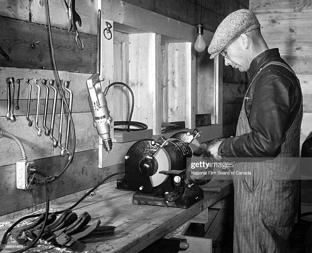 Fabulous A Man Uses An Electric Bench Grinder To Exemplify One Of The Ncnpc Chair Design For Home Ncnpcorg