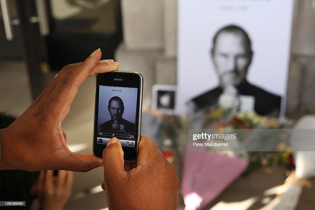A man uses an iphone to photograph tributes to Apple Computer co-founder Steve Jobs outside The Apple Store in Covent Garden on October 6, 2011 in London, England. Jobs, 56, passed away after a long battle with pancreatic cancer. Jobs co-founded Apple in 1976 and is credited, along with Steve Wozniak, with marketing the world's first personal computer in addition to the popular iPod, iPhone and iPad.
