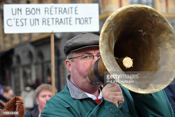 A man uses an old bullhorn on November 6 2010 in the French northern city of Lille as he takes part in a demonstration to protest against President...