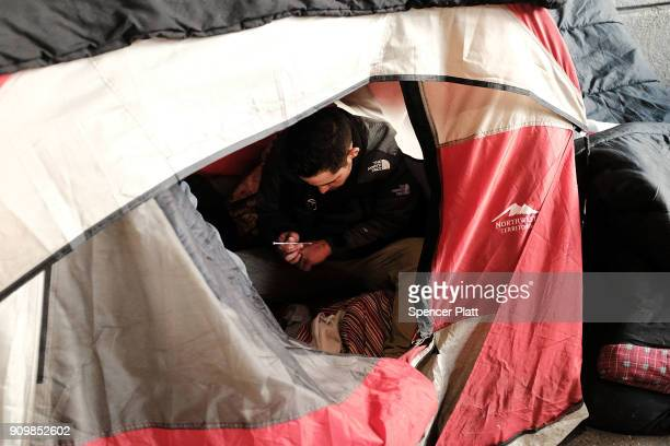 A man uses heroin in a tent under a bridge where he lives with other addicts in the Kensington section which has become a hub for heroin use on...