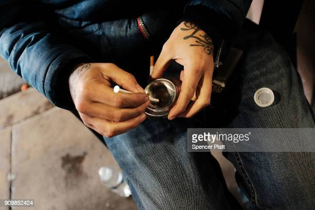 A man uses heroin under a bridge where he lives with other addicts in the Kensington section which has become a hub for heroin use on January 24 2018...