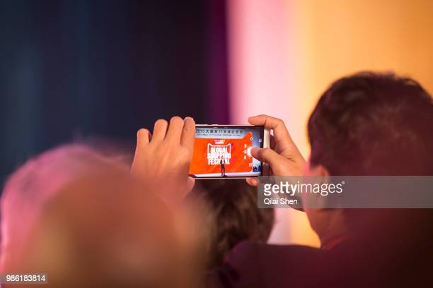 A man uses his cell phone to take pictures of an event promoting the 1111 shopping festival at the Alibaba Group Holding Ltd headquarters in Hangzhou...