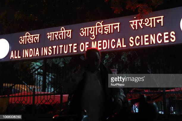 A man uses his cellphone near AIIMS All india institute of Medical Science in New Delhi
