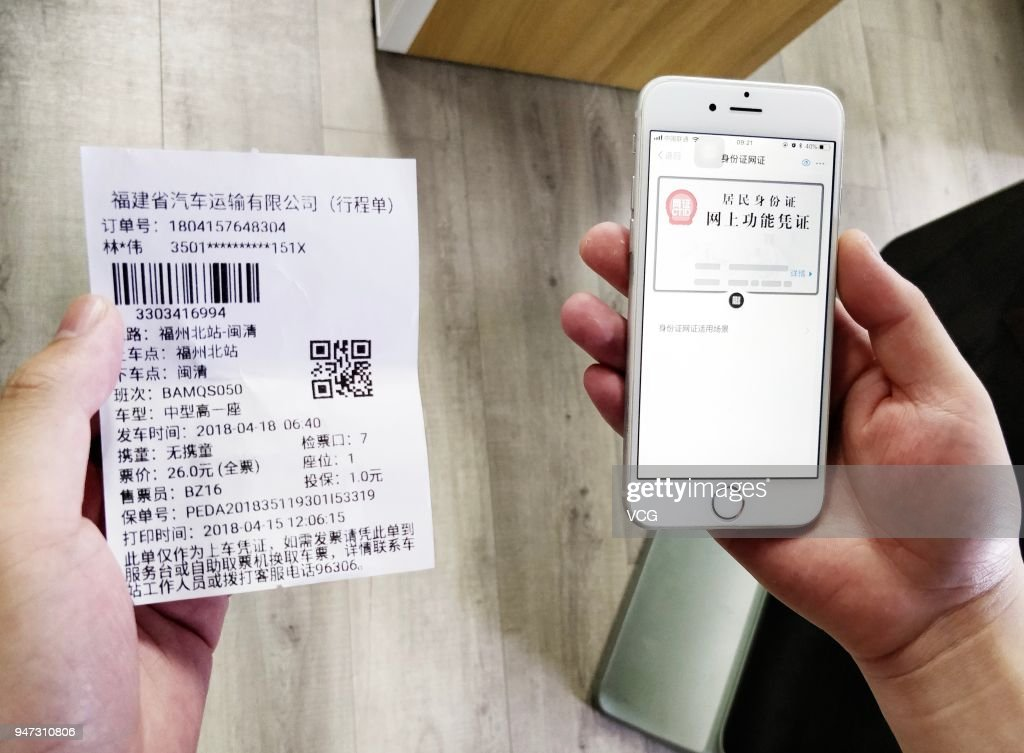 A man uses his 'electronic ID card' in the mobile payment app Alipay to verify himself as he buys bus ticket on April 17, 2018 in Hangzhou, Zhejiang Province of China. 'Electronic ID card' will allow users to check in and go through security checks at railway stations and airports without showing their original ID cards and will be tested in Quzhou, Hangzhou and Fuzhou this April.