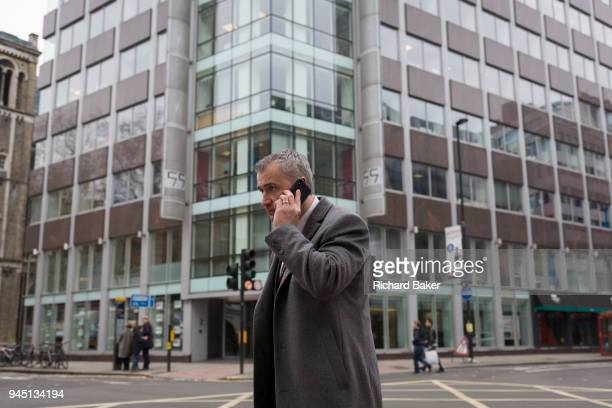 A man uses his mobile phone outside the offices of Cambridge Analytica on New Oxford Street the UK tech company accused of harvesting the personal...