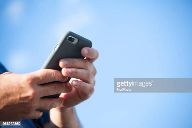 Man uses his smartphone in Warsaw on June 1, 2018.