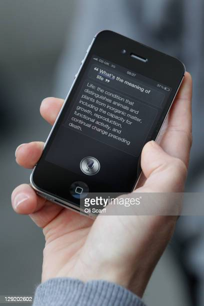 A man uses 'Siri' on the new iPhone 4S after being one of the first customers in the Apple store in Covent Garden on October 14 2011 in London...