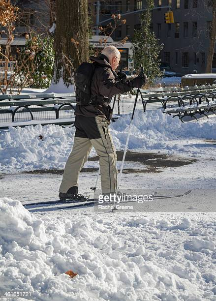 Man uses skis to make his way through Central Park after Winter Storm Hercules left New York City covered in snow.