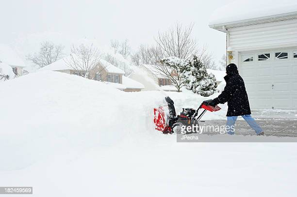 Man uses Snowblower after Blizzard Snow