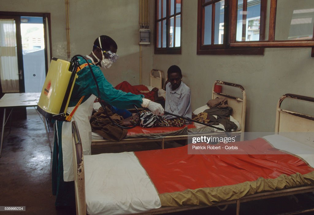 Lovely A Man Uses Spraying Equipment To Disinfect A Bed Used By An Ebola Virus  Victim At