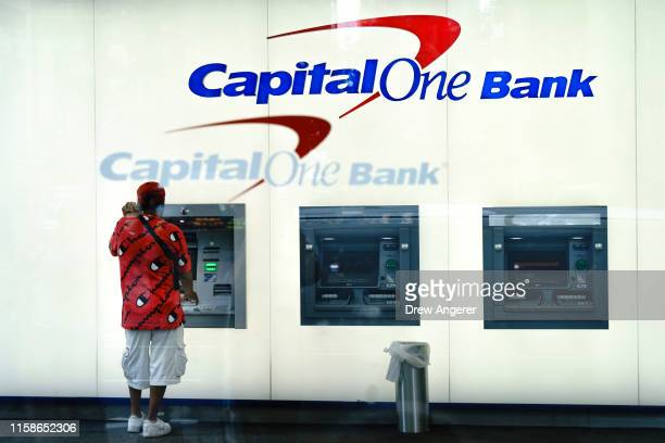 A man uses the ATM at a Capital One bank in Midtown Manhattan on July 30 2019 in New York City In one of the largestever thefts of bank data a...