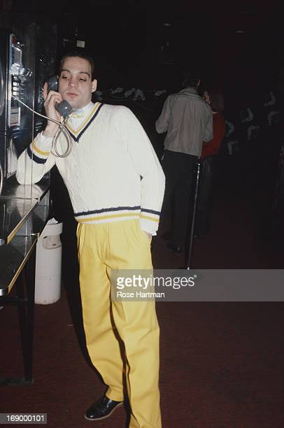 A man uses the payphone inside the 'Peppermint Lounge' nightclub New York City circa 1982