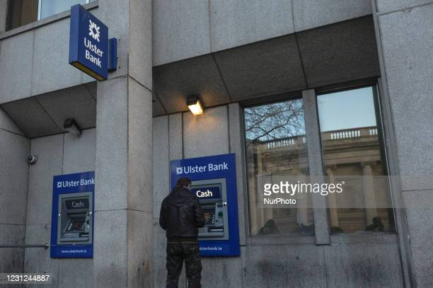 Man uses Ulster Bank's ATM in Dublin city center during Level 5 Covid-19 lockdown. Tomorrow, Friday 19 February, NatWest, the British bank that owns...