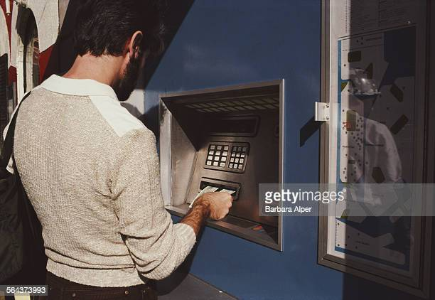 A man using a cash machine in New York City USA October 1983