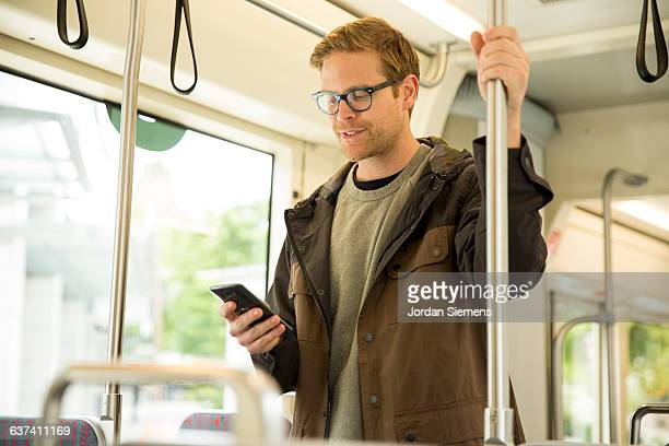 A man using a cell phone on a train
