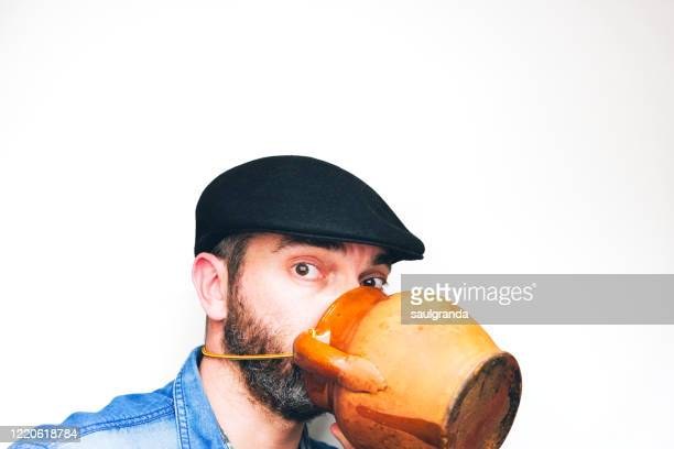 man using a clay pot as a protective mask - satire stock pictures, royalty-free photos & images