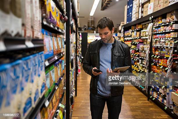 A man using a digital Tablet for shopping.