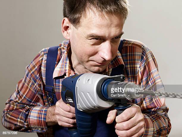 A man using a large drill