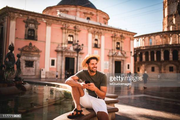 man using a mobile phone - valencia spain stock pictures, royalty-free photos & images