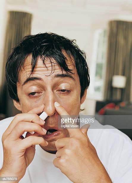 Man Using a Nasal Inhaler