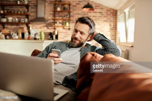 man using a phone - one man only stock pictures, royalty-free photos & images
