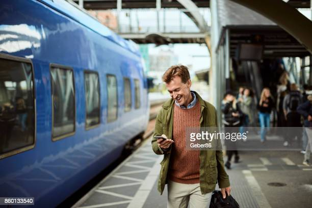 man using a phone - subway station stock pictures, royalty-free photos & images