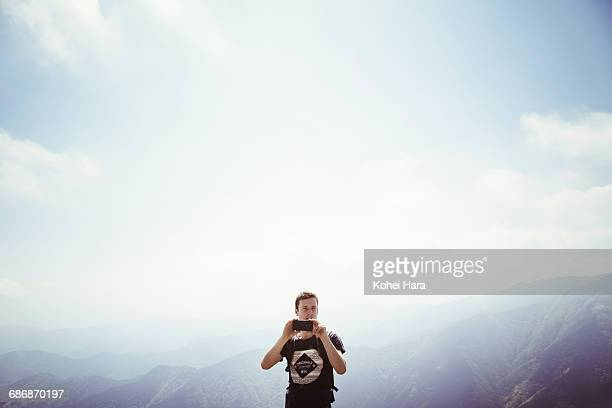 Man using a smart phone in the mountain