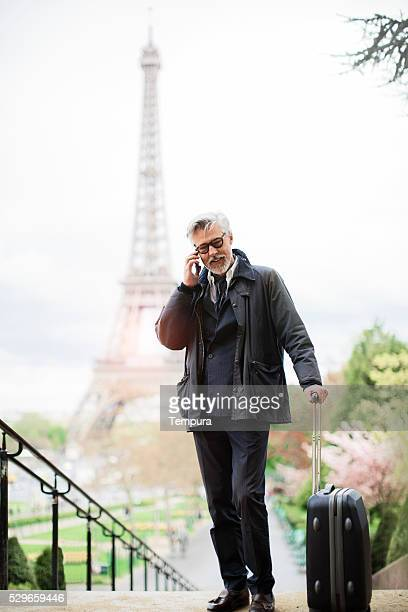 Man using a smartphone at Trocadero near EiffelTower