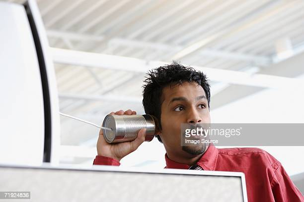 Man using a tin can telephone