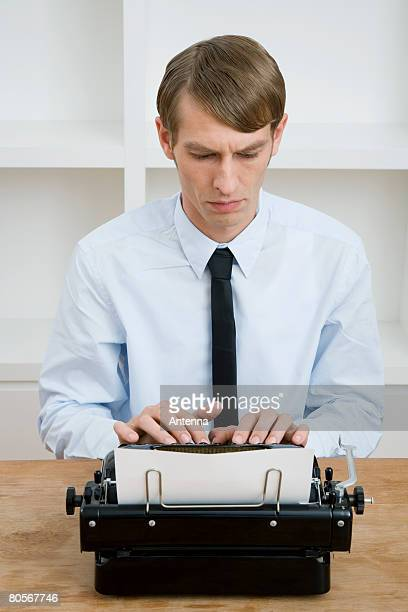 a man using a typewriter - hair part stock pictures, royalty-free photos & images