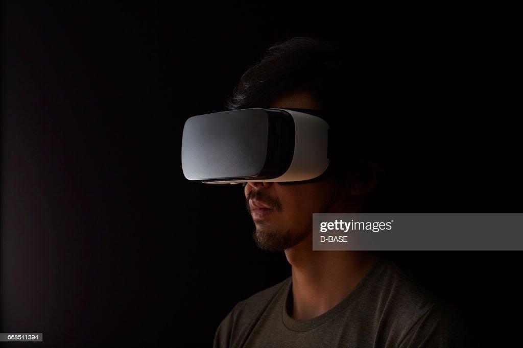 Man using a virtual reality headset : Stock Photo