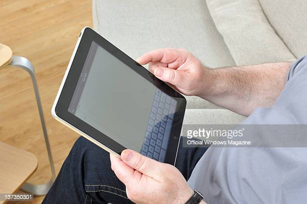 Man using an Apple iPad, during a shoot for Official Windows Magazine, September 20, 2010.