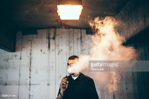 Man Using An Electric Cigarette