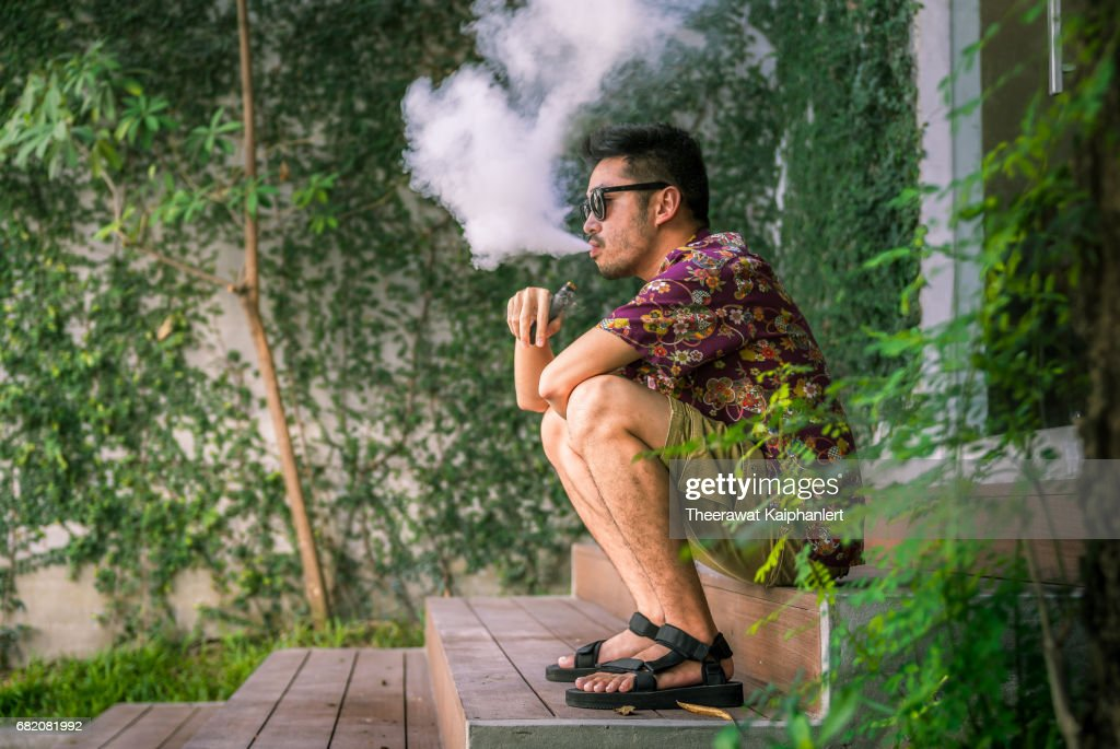 Man Using An Electric Cigarette : Stock Photo