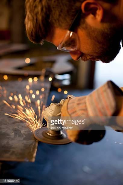 Man Using Angle Grinder on Metal