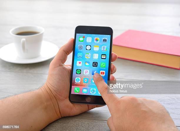 Man using Apple iPhone 6 Plus