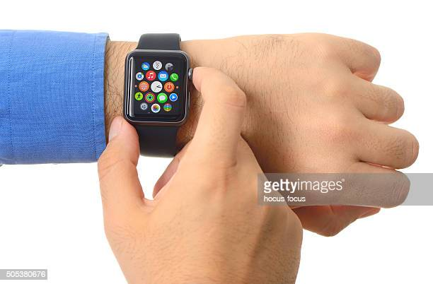 Man using Apple Watch on white background