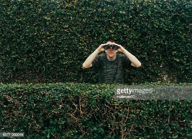 man using binoculars - surveillance stock pictures, royalty-free photos & images