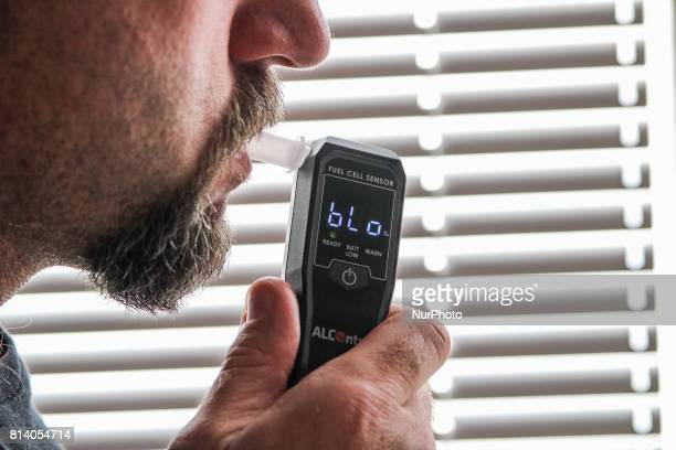 Man using breathalyzer is seen on 27 June 2017 in Gdansk Poland The police is stopping fewer drivers for drunk driving in Poland Still in 2010 142...