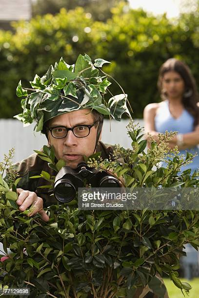 man using bush as camouflage - bush stock pictures, royalty-free photos & images