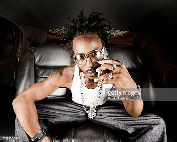 man using cell phone in limo - pimped car stock photos and pictures