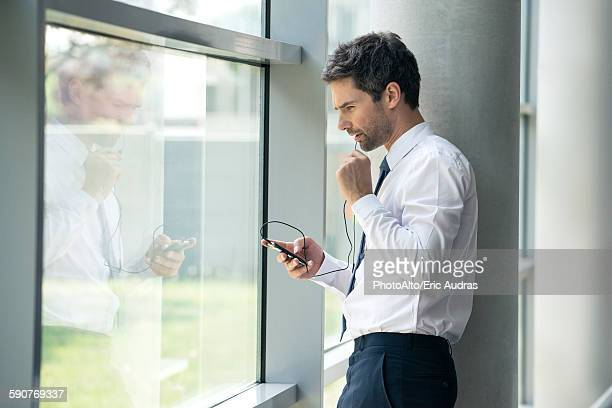 Man using cell phone with hands-free device