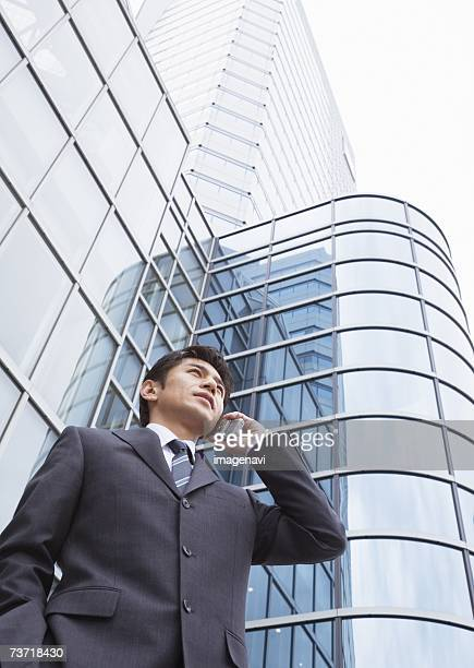Man using cell-phone at outside of building