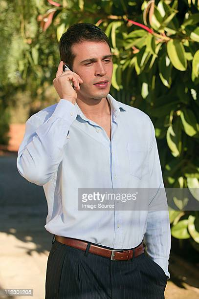 Man using cellphone outdoors