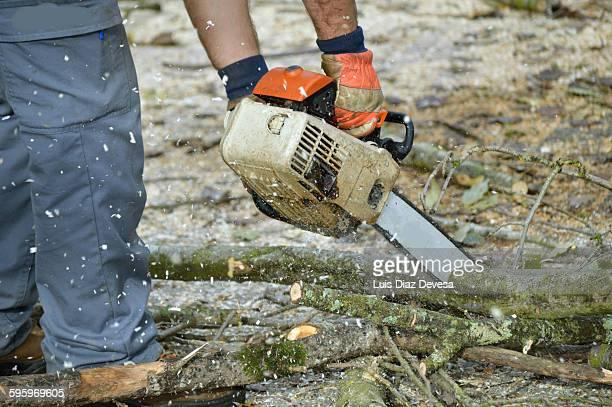 Man using chain saw