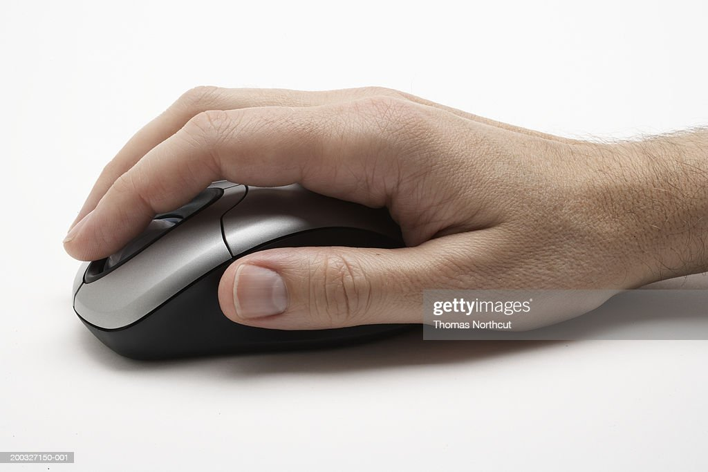 Man using computer mouse, close-up of hand, side view : Stock Photo