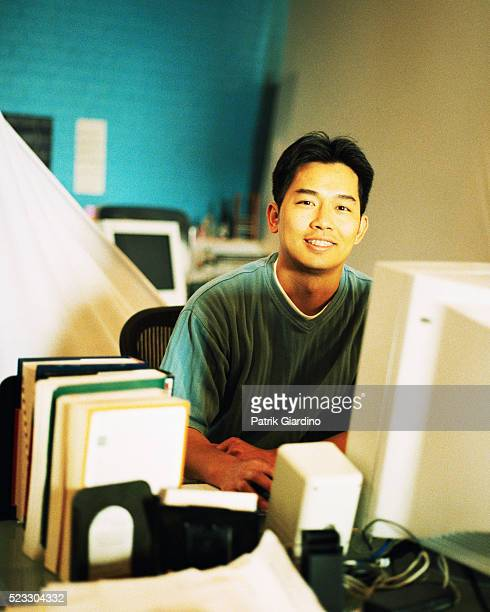 man using computer - bookend stock pictures, royalty-free photos & images