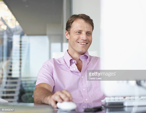 Man using computer, smiling