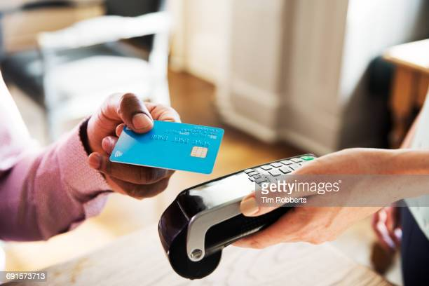 Man using contactless payment, close up