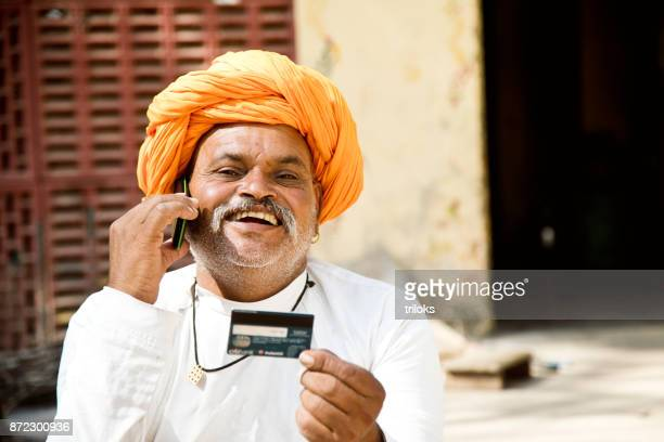 Man using credit card and mobile phone